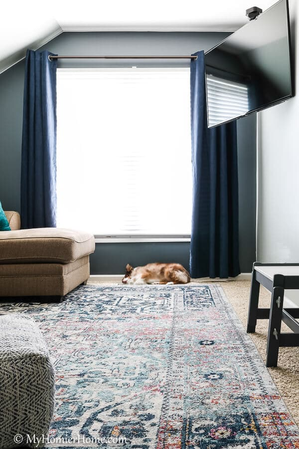 The bonus room has become one of our favorite spots with the moody color Irony by Clare paint