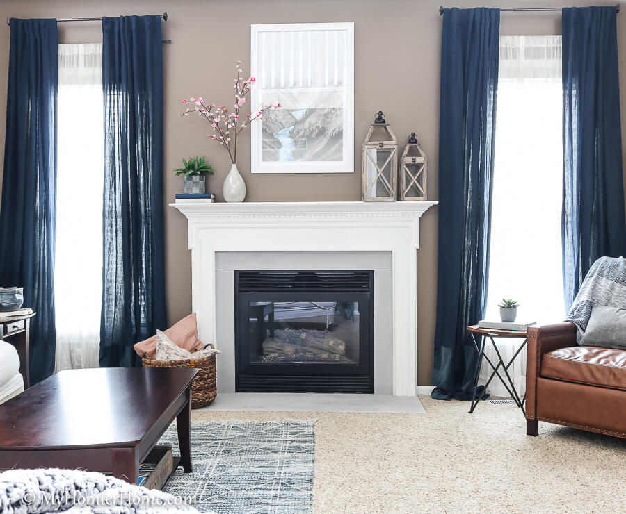 How far we've come in this living room! This fireplace surround used to be a gross beige. Now it is a beautiful light gray!