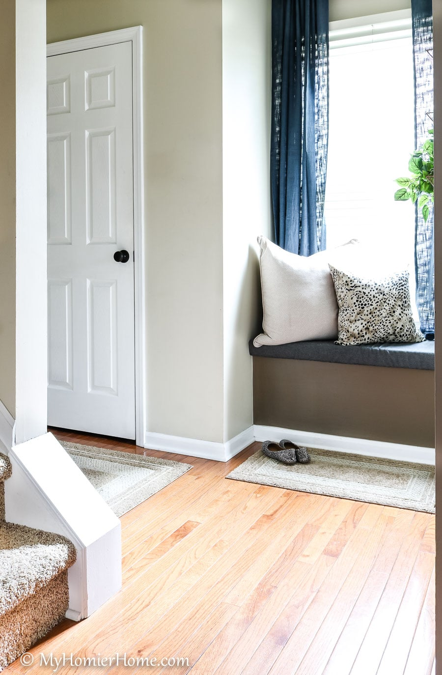 Learn how I transformed my tiny entryway window seat into a beautiful and functional space.