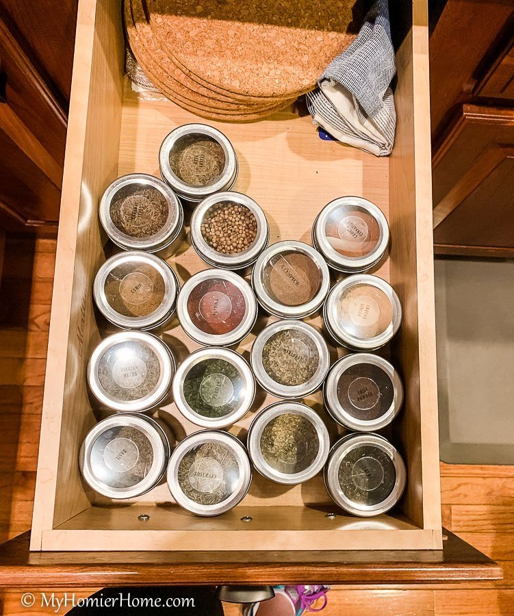 How to organize your kitchen cabinets using clear and simple strategies to tackle kitchen cabinet dysfunction without losing your mind. Spices drawer before