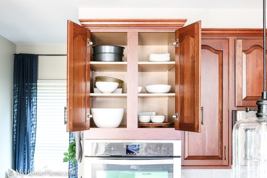 How to organize your kitchen cabinets using clear and simple strategies to tackle kitchen cabinet dysfunction without losing your mind - Above the stove (after)