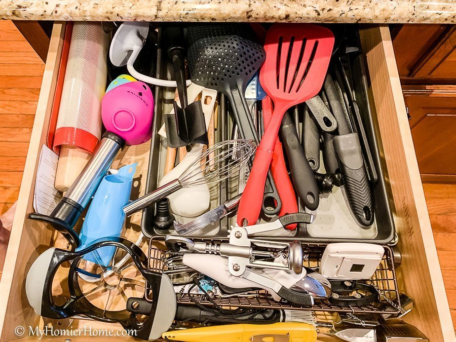 How to organize your kitchen cabinets using clear and simple strategies to tackle kitchen cabinet dysfunction without losing your mind. The extra utensil drawer before... yikes!