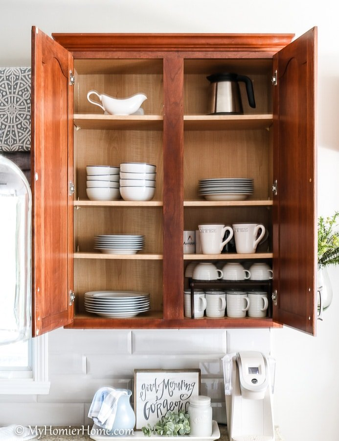 How to organize your kitchen cabinets using clear and simple strategies to tackle kitchen cabinet dysfunction without losing your mind. Doesn't the after look so much better? Plates are easily accessible and the mugs are easy to grab and go near the coffeemaker.