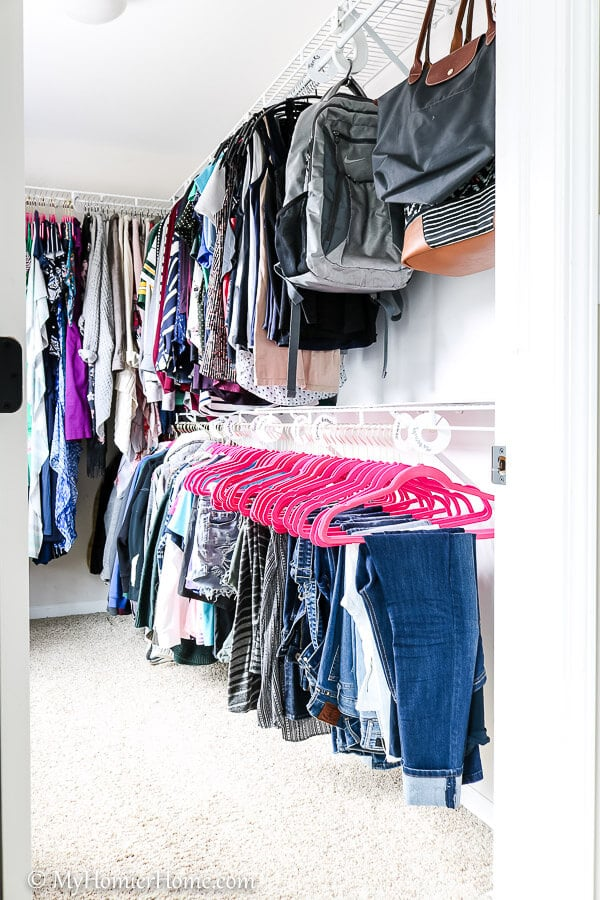 When organizing your master closet, keep items sorted for easy access.