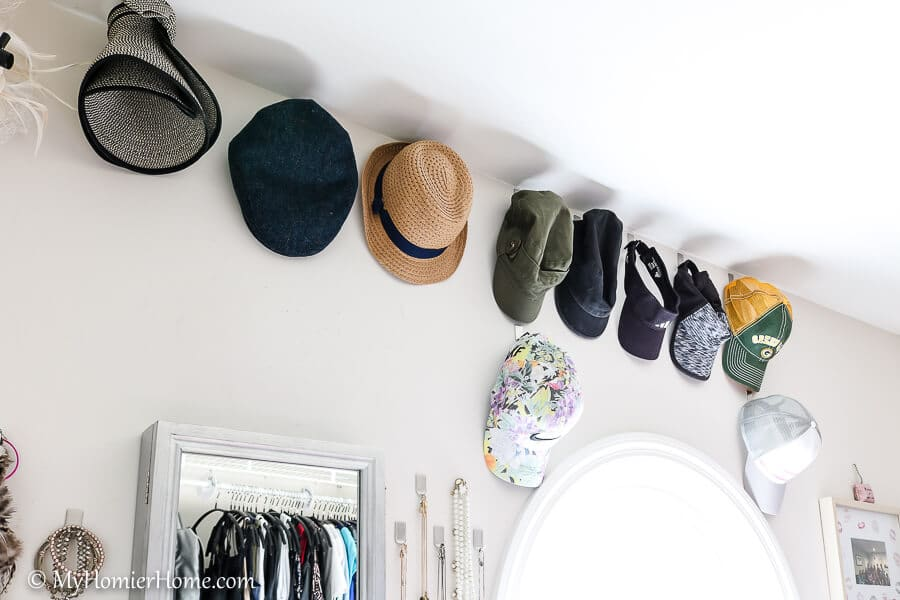 Organizing the master closet by getting hats on display.