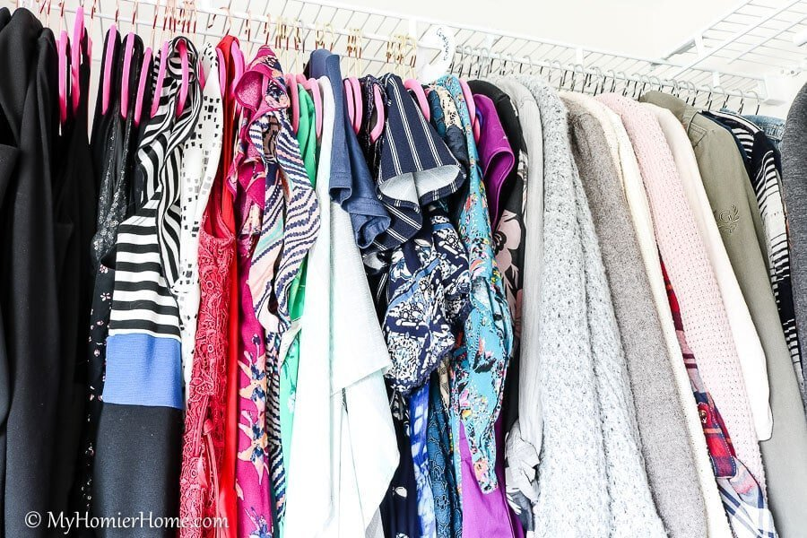 Use dividers to keep different groupings of clothes separated to best keep your closet organized.