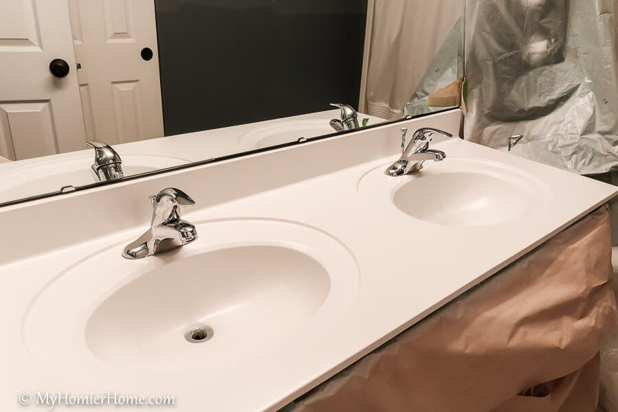 spray painting bathroom countertops is my new favorite way for a cheap and easy way to update a dingy counter.