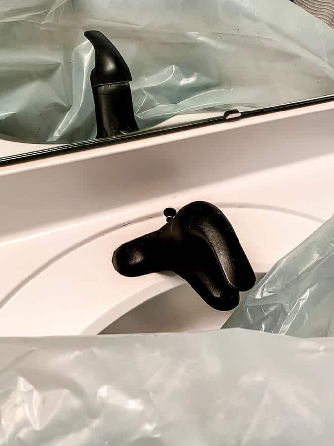 Sneak peek at the faucet sprayed.
