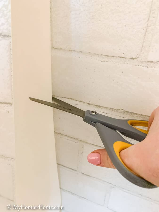You may need to cut the excess off if it begins to be too much paper before reaching the bottom of your wall.