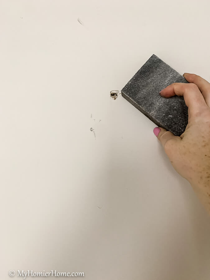 Make sure the wall underneath where you will hang your peel and stick wallpaper is smooth. You can use a sanding block for this.